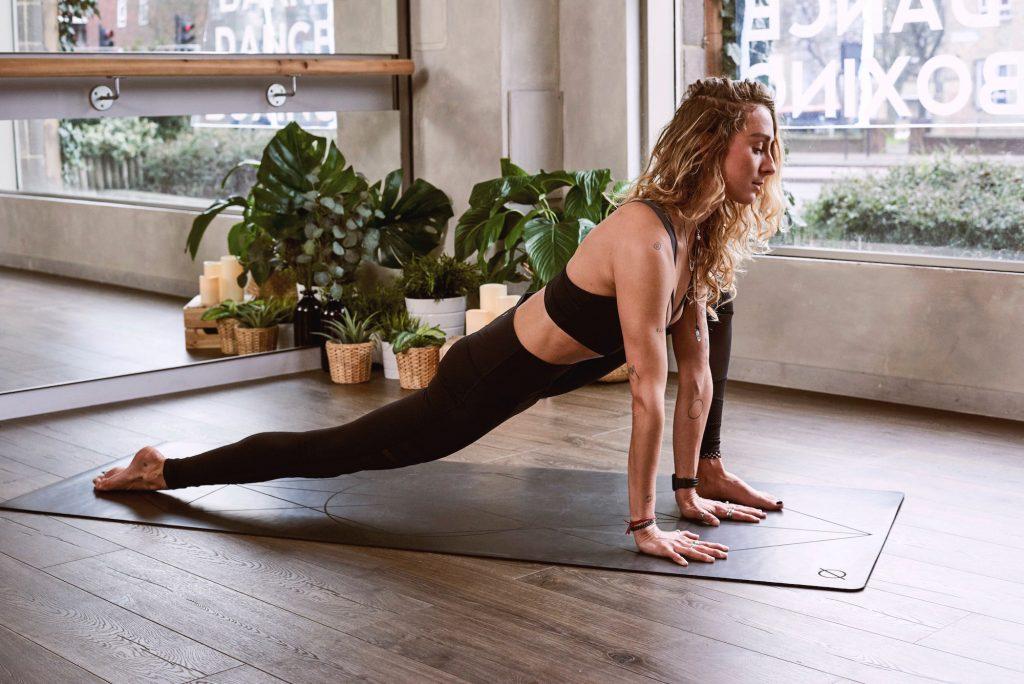 woman doing yoga, joy-inducing morning routine